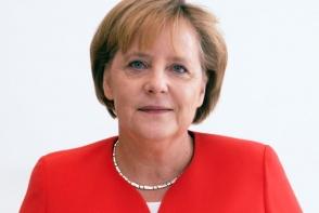Angela Merkel, alaturi de sot, la schi. Vezi cum petrec timpul cei doi in bijuteria alpilor elvetieni - FOTO
