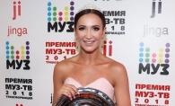 Frumoasa sau ridicola? Olga Buzova si-a facut aparitia intr-o rochie cu trena de 10 metri - FOTO
