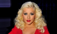 Desi s-a ingrasat, Christina Aguilera se simte minunat in pielea ei. Vedeta a pozat topless - FOTO